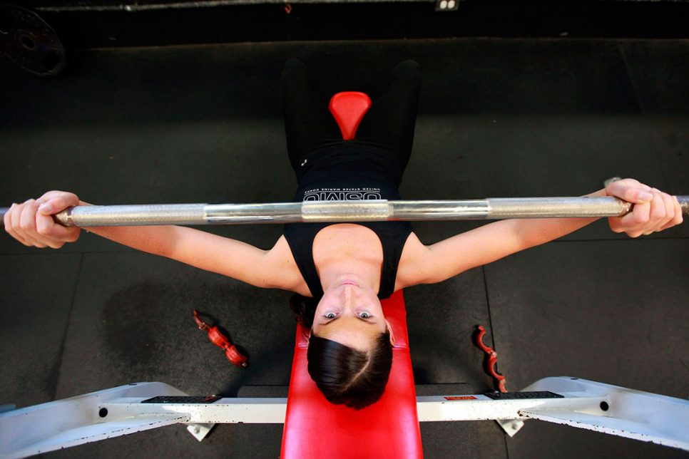 woman bench pressing
